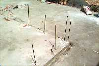 [rebar rods driled into slab]